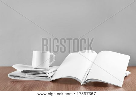 Blank goods on wooden table and grey background