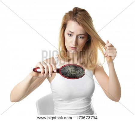 Young woman with hair loss problem on white background