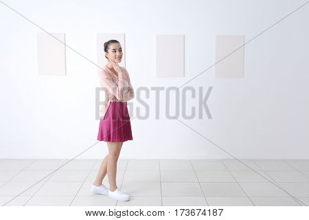 Young woman at art gallery