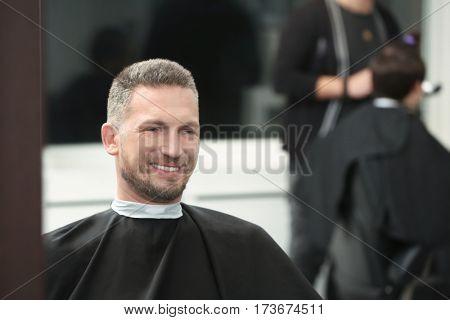 Happy client in barbershop
