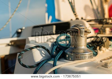 Winch and rope on sailing boat in the sea. concept boating.