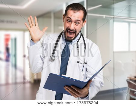 Shocked doctor reading a document