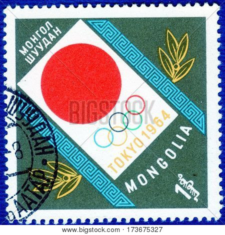 MONGOLIA - CIRCA 1964: Postage stamp printed in Mongolia with a picture of a symbol Olympic games in Tokyo, with the inscription