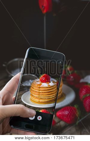 Breakfast Time with Fresh Strawberry on Stack of Pancake Pouring over by Maple Syrup for food ad or website promote