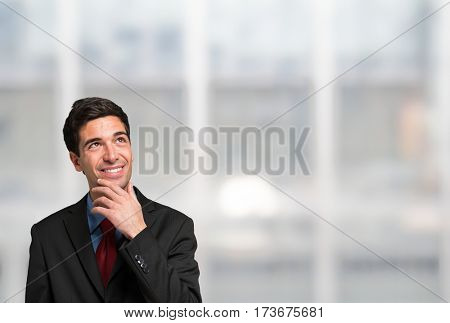 Businessman looking up to the bright copy-space