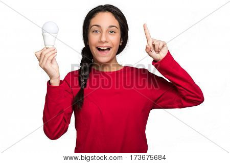 Smiling girl having an idea and holding a light bulb