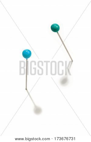pins with green head on a white background