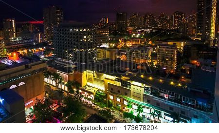 Colorful night life lights of Waikiki city from top overlook. Oahu island Hawaii, United States. City night lights and nightlife concept.