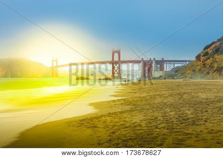 Spectacular view of Golden Gate Bridge from Baker Beach at sunset on popular Baker Beach.Holidays, travel and leisure concept. San Francisco, California, United States.