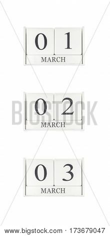 Closeup group of white wooden calendar with black 1 2 3 march word three date calendar isolated on white background