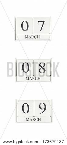 Closeup group of white wooden calendar with black 7 8 9 march word three date calendar isolated on white background