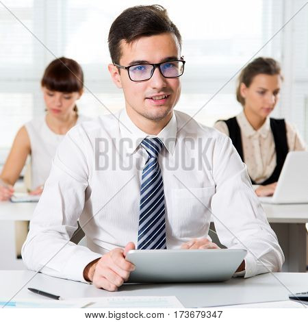Businessman working with tablet computer in an office