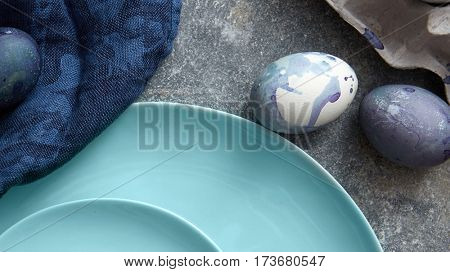 plate with blue eggs and a napkin