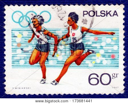 POLAND - CIRCA 1967: Postage stamp printed in Poland with a picture of a athletes runners, from the series