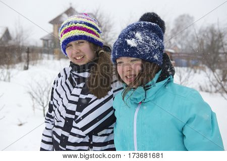 Two teenage girls in winter clothes