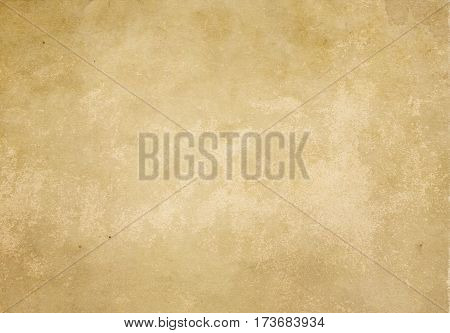 Old and yellowed paper background for the design. Grunge style.