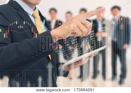 Business Man Trading Concept Using The Tablet With Financial Graph On Cityscape Background, Double E