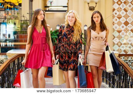 Young beautiful women with some shopping bags walking in the mall