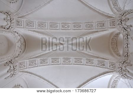 Grodno, Belarus - February 11, 2017: Looking up at a white decorative ceiling of ancient synagogue in Grodno.