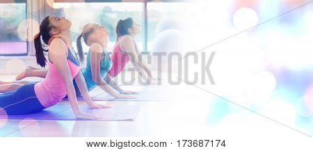 Glowing background against friends exercising on mats