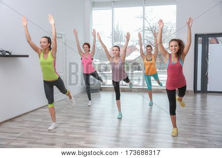 Beautiful girls training in gym