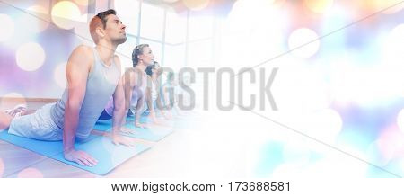 Glowing background against people exercising in row