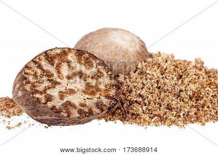 Nutmeg whole half and ground on white background close up.