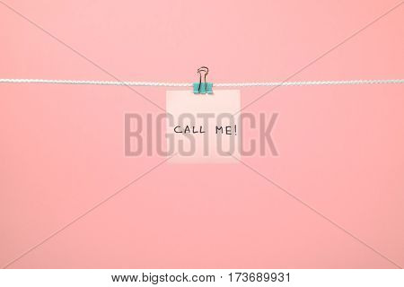 Pink Paper Note On The String With Text Call Me!