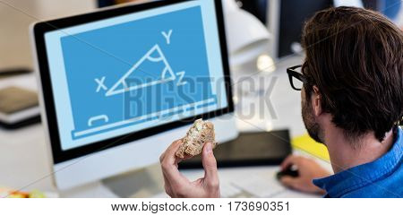 Print against high angle view of man working on computer