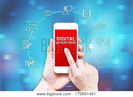 Hand Holding Smart Phone With Digital Advertising Word And Icon On Blue Pixel Blur Background, Digit