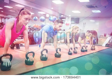 Abstract background against fit people working out in fitness class