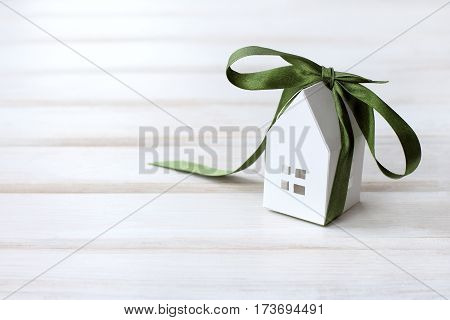 layout houses tied up by festive green bow / desired gift dreams
