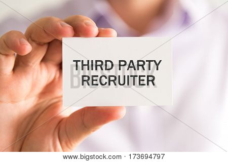 Businessman Holding A Card With Third Party Recruiter Message
