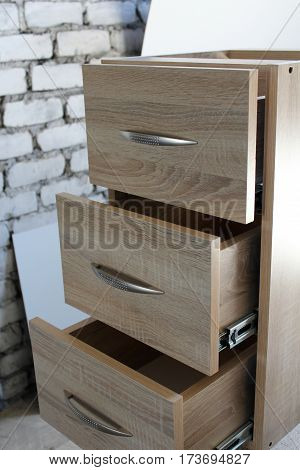 Furniture manufacture. Wooden bedside table. small business