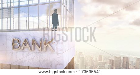 Businessman standing against low angle view of facade of office building