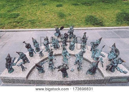 Wroclaw, Poland - September, 20th, 2016. Wroclaw dwarf orchestra near National Forum of Music. Bronze gnome sculptures are the main tourist attraction and symbol of the city.