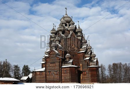 Russian wooden church has a lot of domes. Traditional architecture in the culture of Russia. Orthodox Christian Church of the Intercession of the Holy Virgin. St. Petersburg.