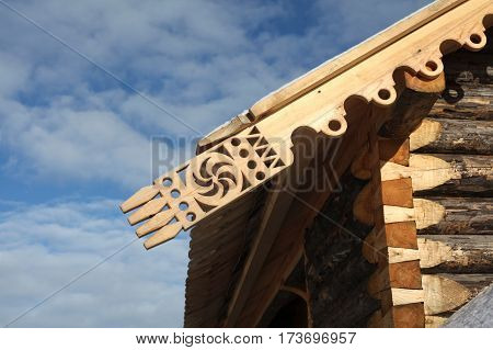 Symbol of the sun in the traditional culture of the Slavs and Russian. Russian wooden architecture - the house made of logs and carvings