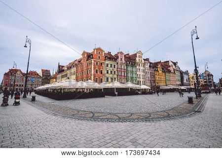 Wroclaw, Silesia, Poland - September,19th, 2016. Traditional colorful houses, tourist walkway and pavement at Wroclaw Old Town Market Square Rynek panoramic view. One of the famous city landmarks.