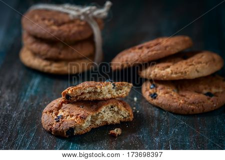 Oatmeal Cookies With Raisins, Chocolate Folded In A Pile On The Old Table, Wood Background