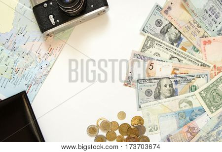 Money of different countries of the world, camera, map and passport on white background. The concept of travel. top view