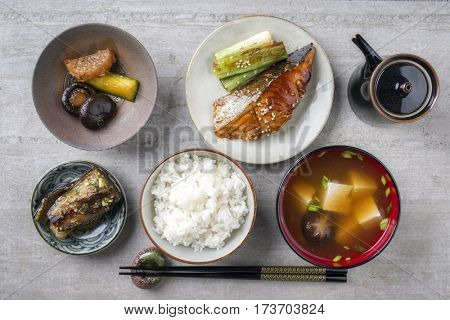 Traditional Japanese dish with Fish Teriyaki and Miso Soup as close-up in bowls