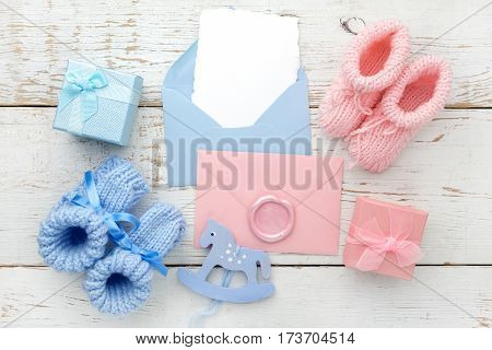 Set of baby girl and boy booties and greeting card form.