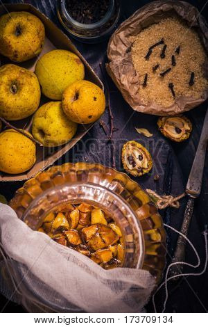 Ingredients Tinctures Fruits Twigs Quince Sugar Cloves Vanilla Wooden Table