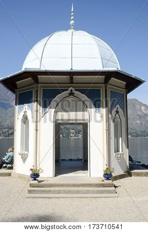 Bellagio Italy - 13 April 2015: People resting and eating at the summerhouse of Villa Melzi at Bellagio on lake of Como Italy