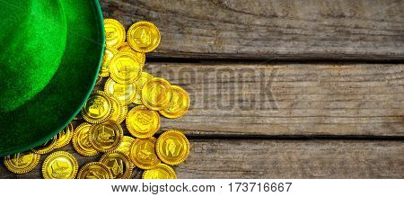 Composite image of Leprechaun hat and gold coins