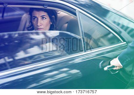 Doorman open the door for businesswoman
