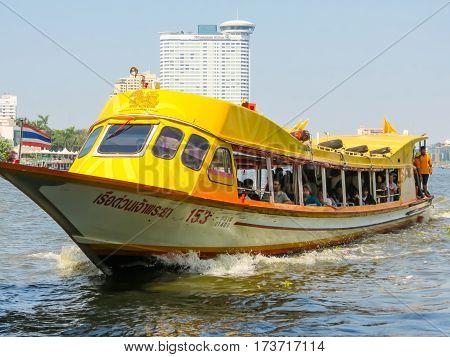 BANGKOK, THAILAND - JANUARY 17, 2014: Ferryboat public motorboat on Chao Phraya River. Bangkok, Thailand