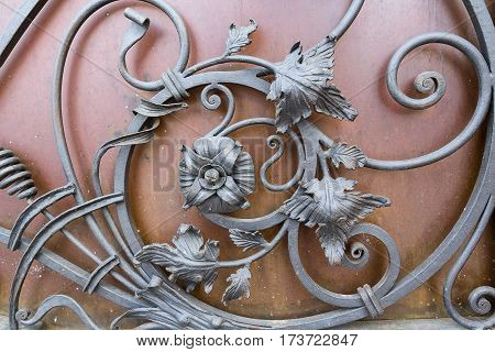 Forged metal elements on the gate. Industry