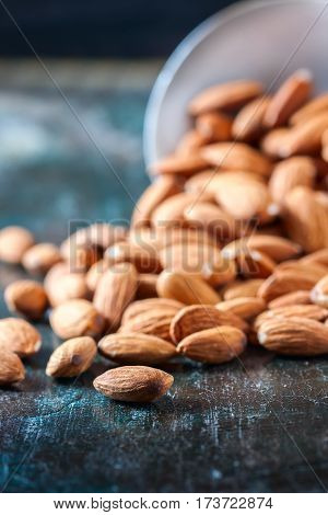 Almond On Wooden Background. Peeled Almonds.